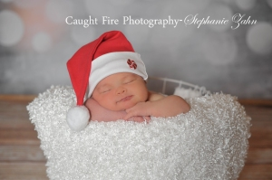 copyright Caught Fire photography 2015, stephanie zahn, christmas photograph, newborn at christmas, baby's first christmas, posed newborn