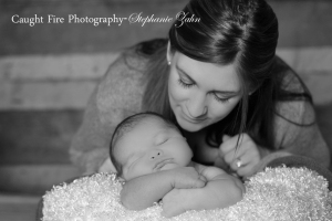 black and white newborn photograph, mom with baby, copy right caught fire photography 2015, stephanie zahn, newborn pose